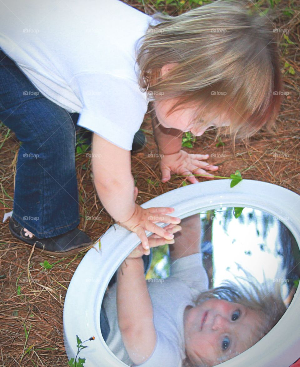 Who are you. Little girl's reflection