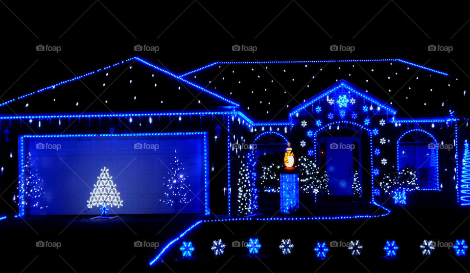 True Blue lighted residence! Beautiful magical blue Christmas lights outline this residence where a competition goes on!