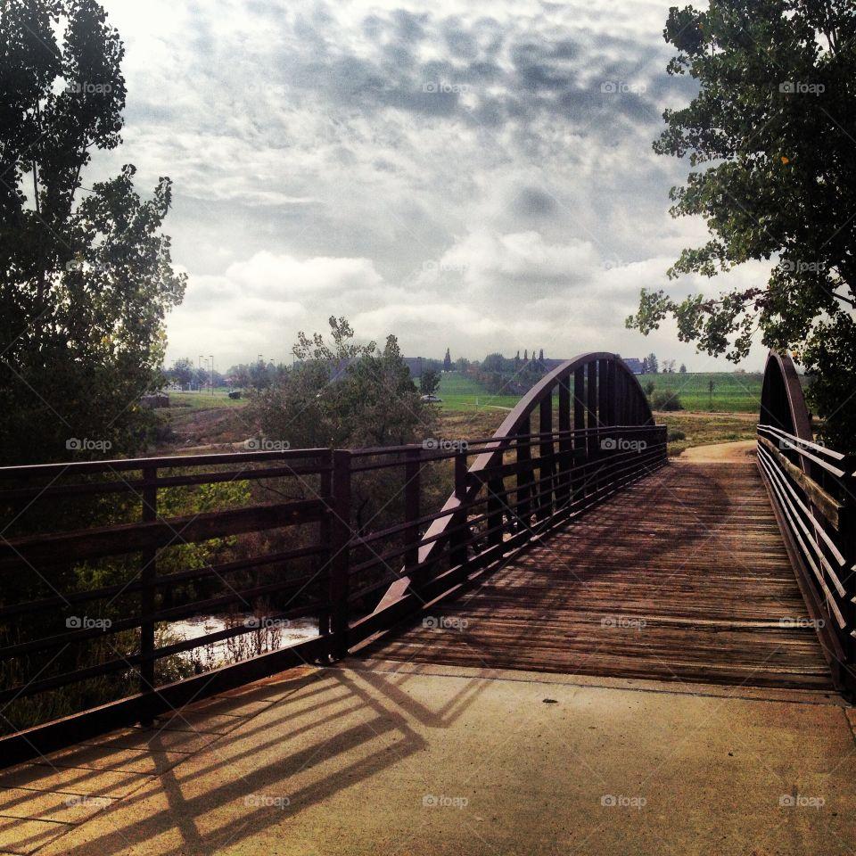 A wooden foot bridge across a creek