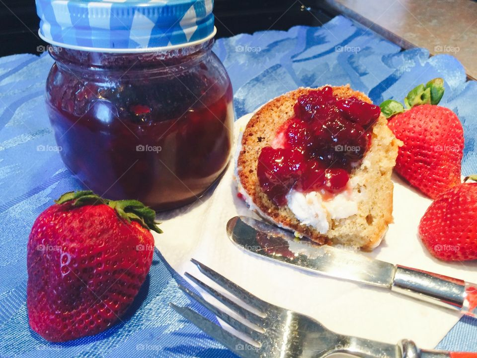Delicious jam on bread with strawberry and napkin