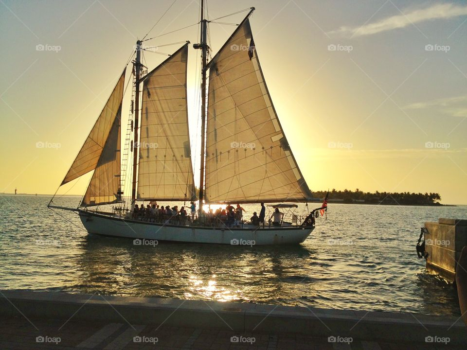 A romantic sailing at sunset. A romantic sailing at sunset across key west