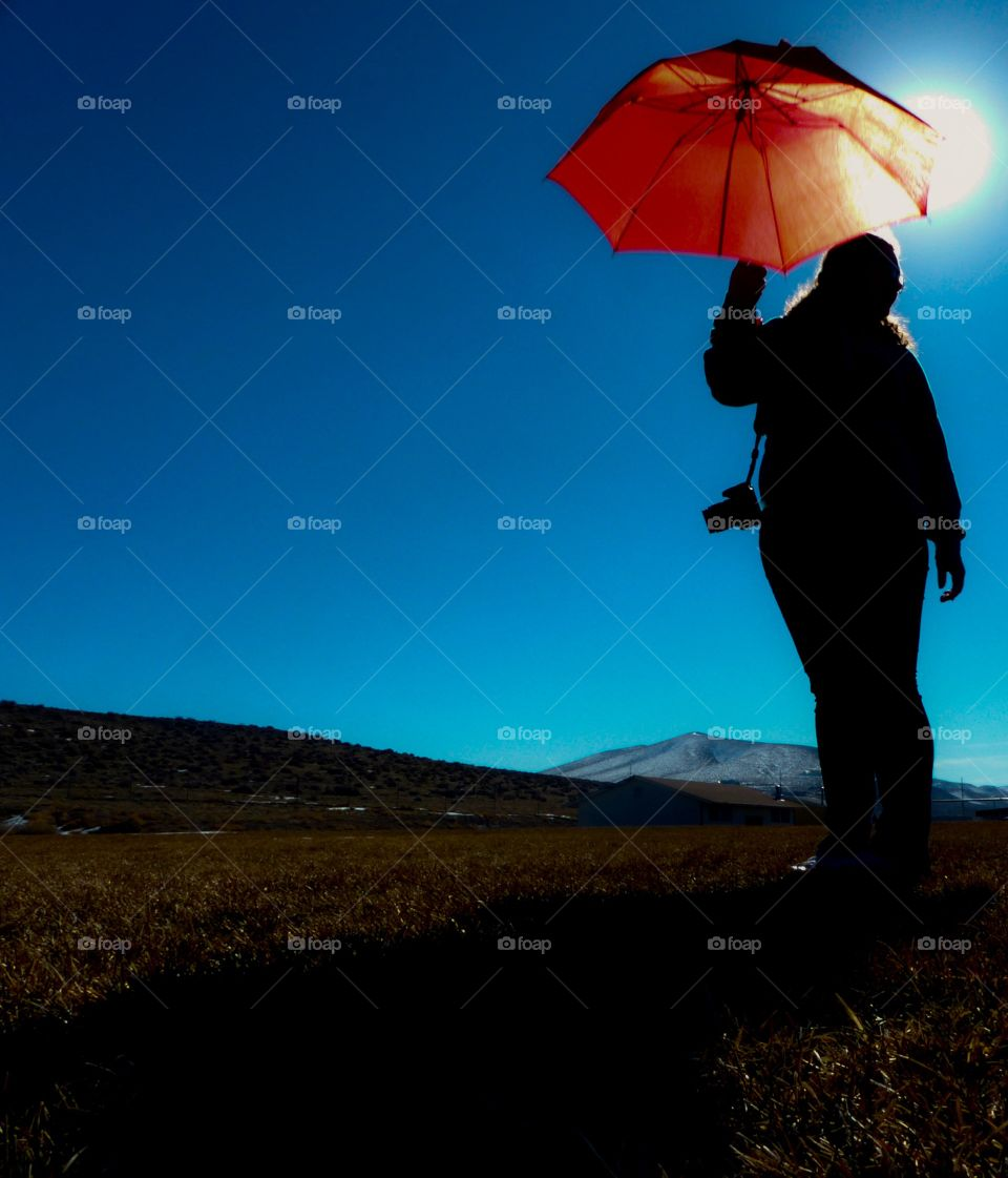 A Red Umbrella with a Silhouette
