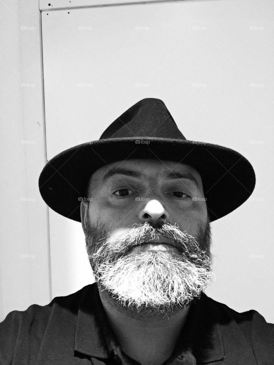 Man with beard wearing hat