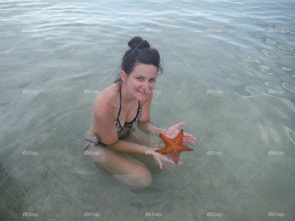 woman and starfish