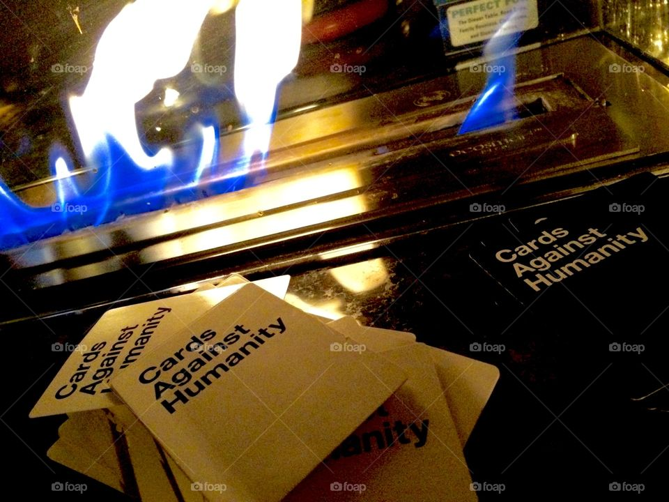 A flame and cards against humanity game cards