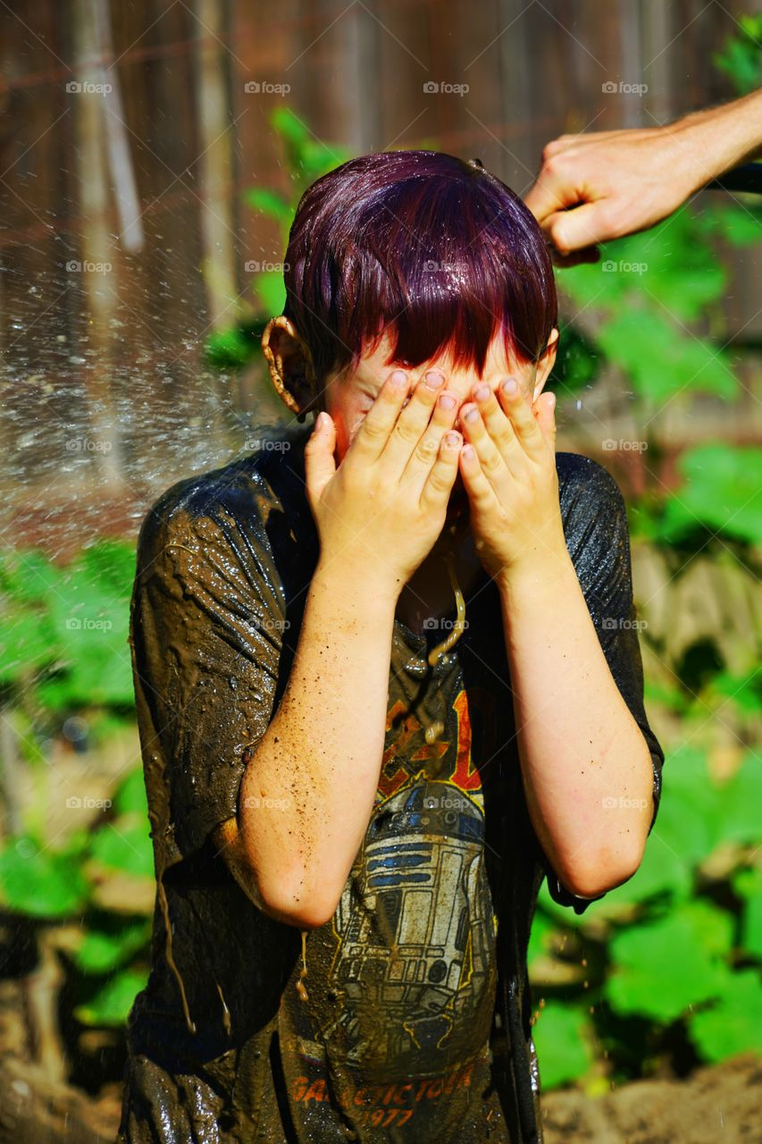 Boy Sprayed In The Face With Water