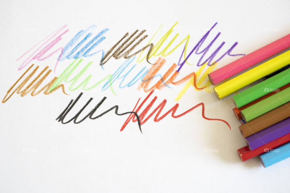 Close-up of colored scribbled on white background