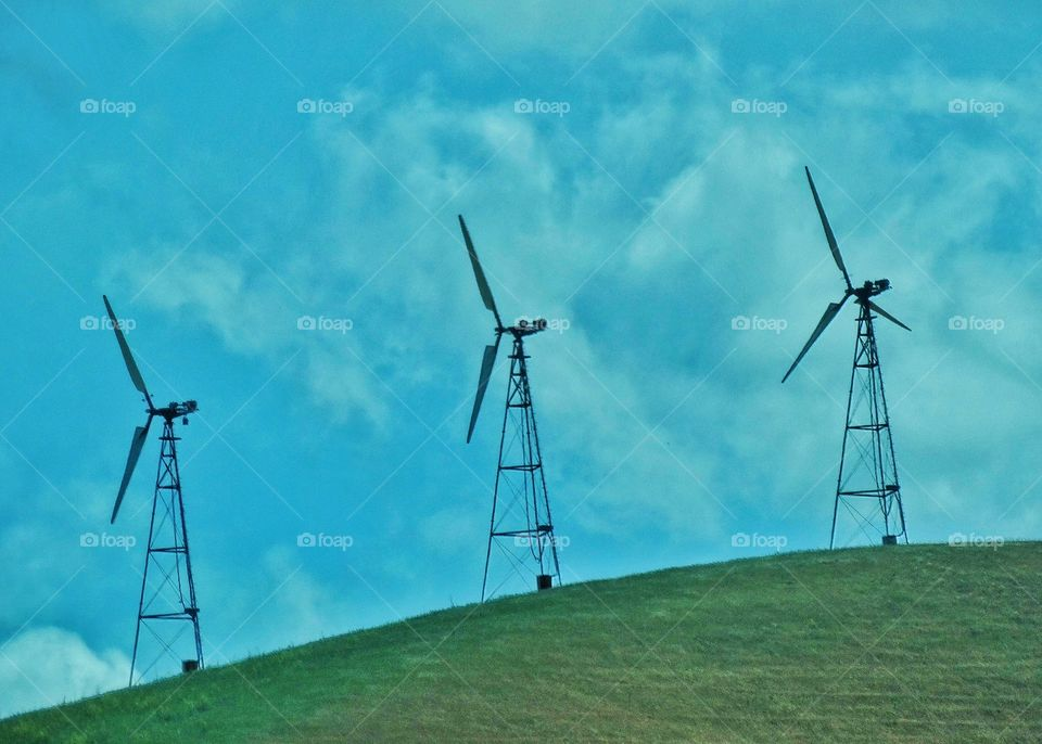 Wind Power Turbines. Wind Turbines On A Green Hill Generating Renewable Power In California