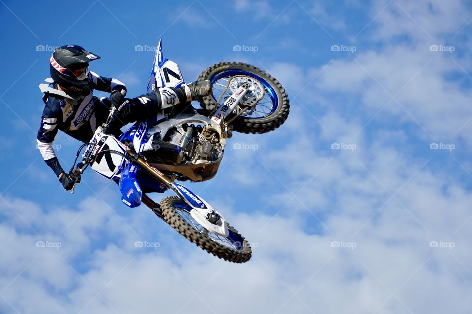 Motocrosser controlling his motorcycle fling through the air