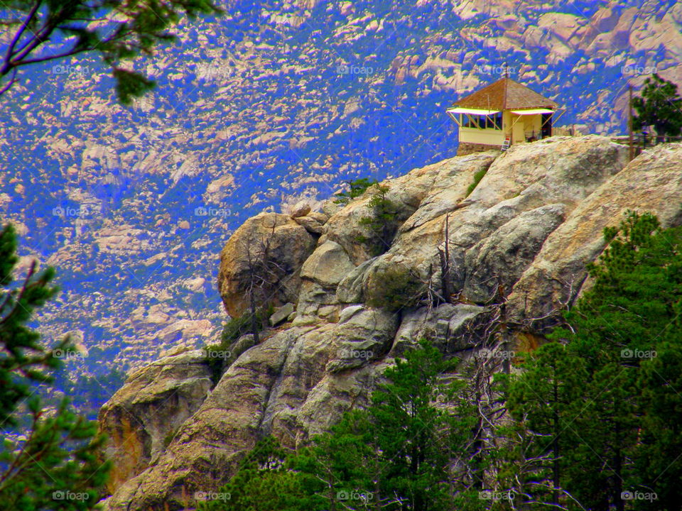 Isolation. review of a hut to the right Lemon Mountain , Tucson , Arizona. I believe it is a fire watch post.