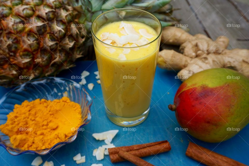 Pineapple mango coconut turmeric coconut cinnamon ginger smoothies
