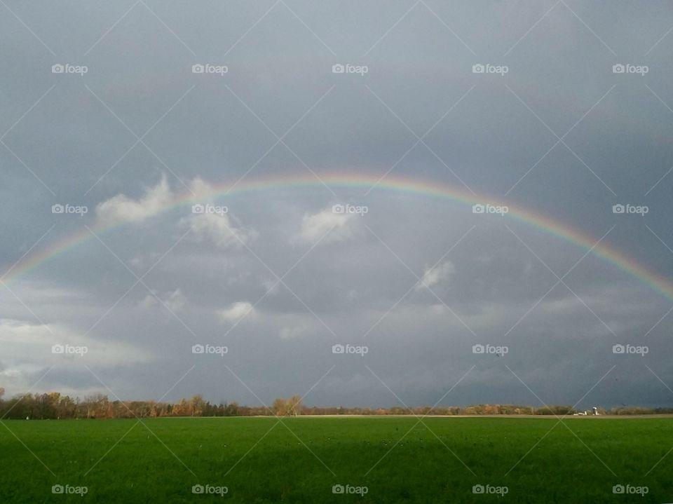 Rainbow over rural Ohio countryside