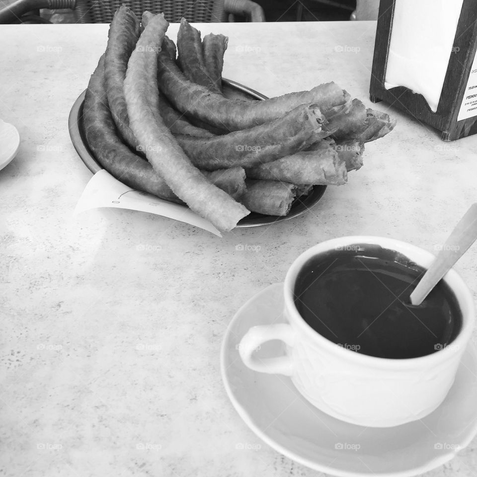 Spanish breakfast consisting of Churros con chocolate