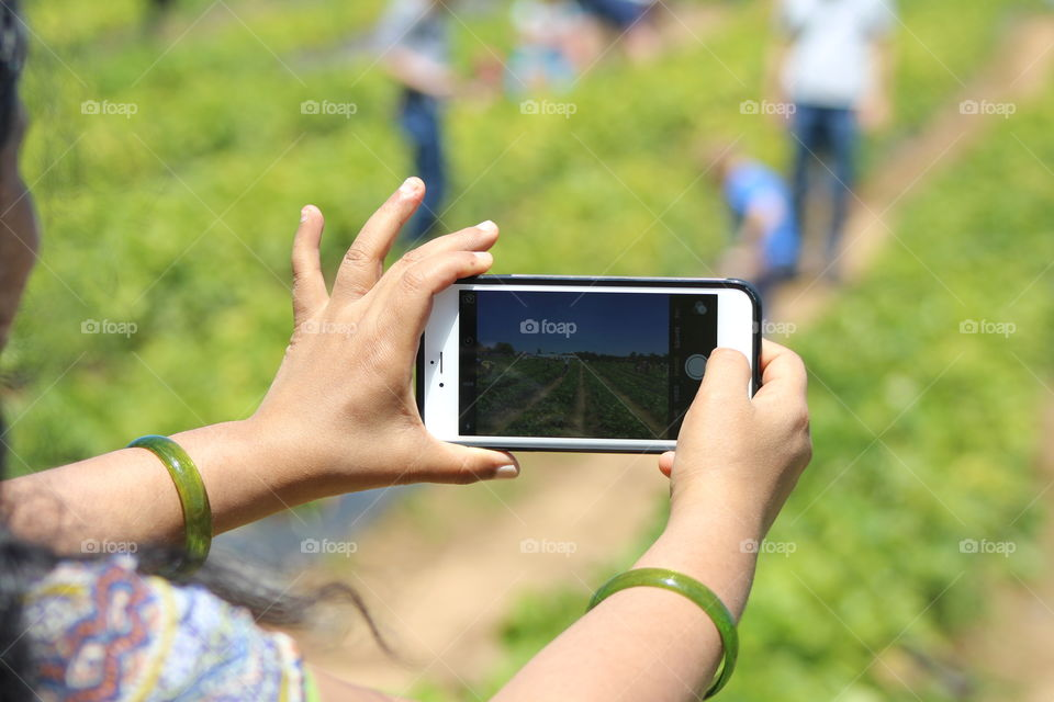 young woman snapping photo from her phone