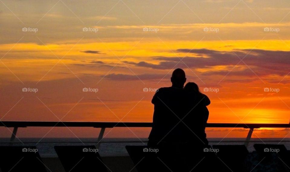Loving couple in sunset