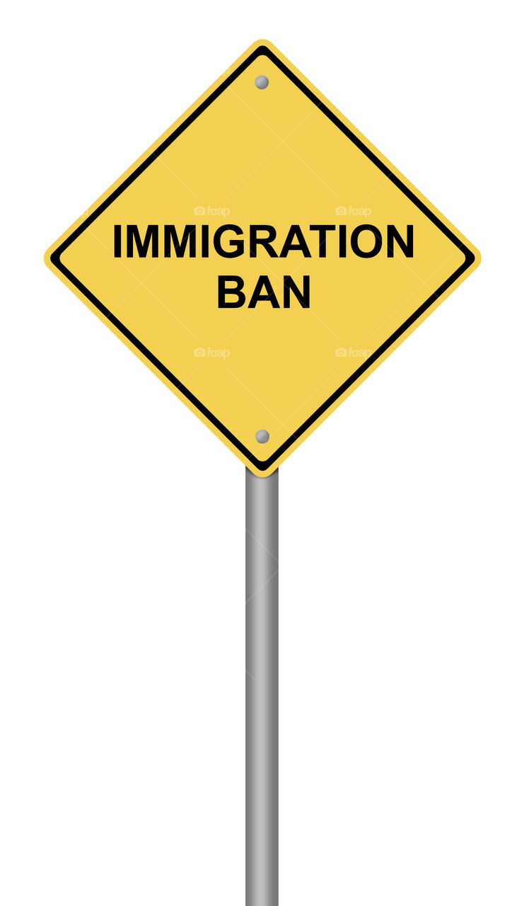 Warning Sign Immigration Ban  Yellow warning sign with the text Immigration Ban.