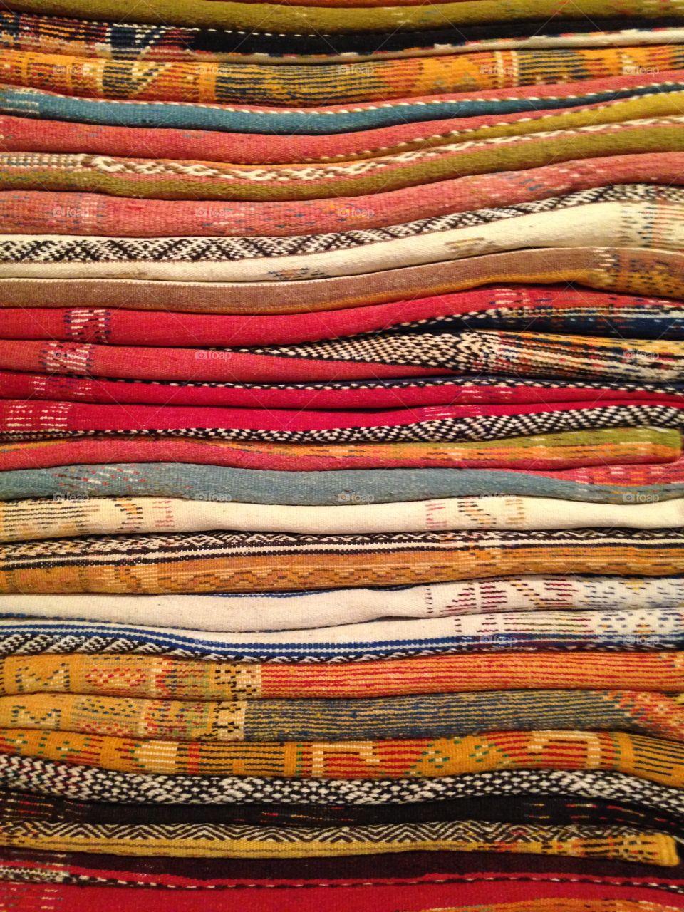 Pile of Antique Rugs in Marrakesh Market