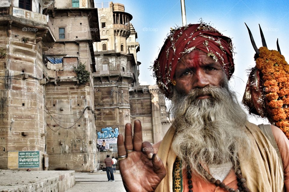 Om - the word has one hundred meanings . Man asks me to take his photo in Varanasi