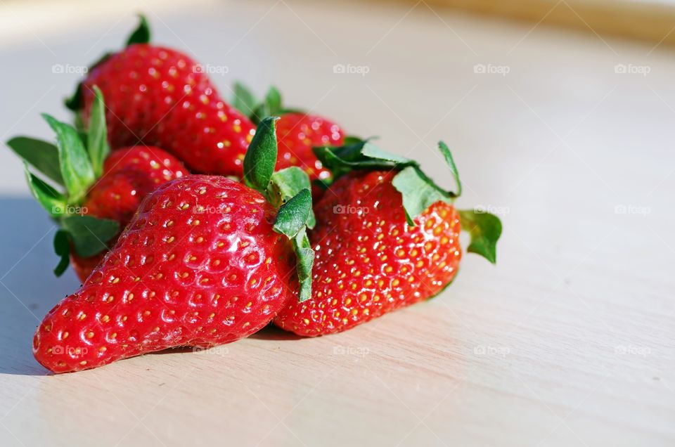 Red ripe strawberry on table