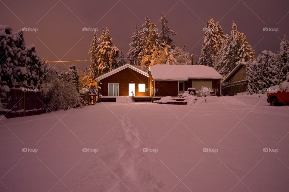 House covered with snow on snowy landscape