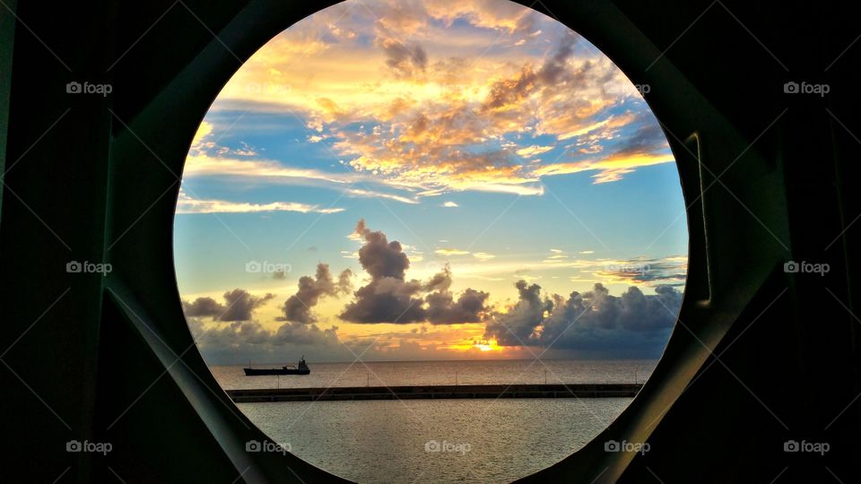 View of tanker ship from Port hole on Cruise ship