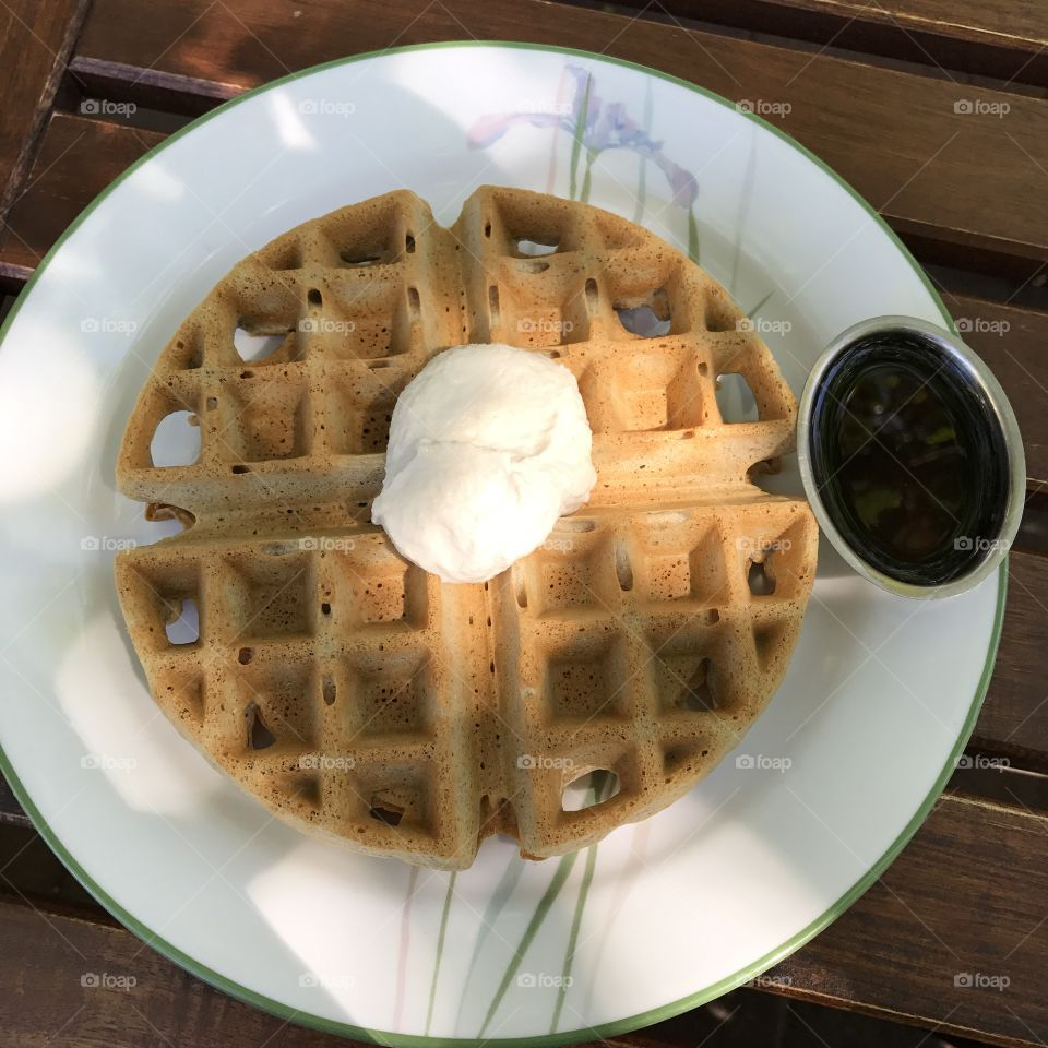 Vegan & gluten-free buckwheat waffle with macadamia butter and side of maple syrup, from ChocolaTree inSedona, AZ