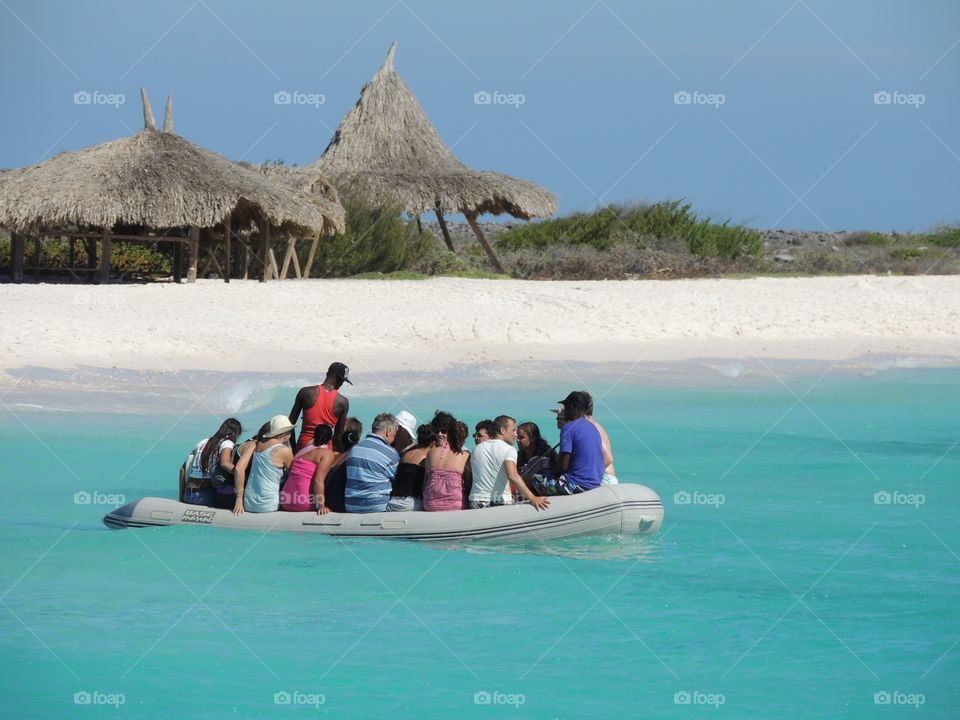 Riding by boat on a beautiful beach