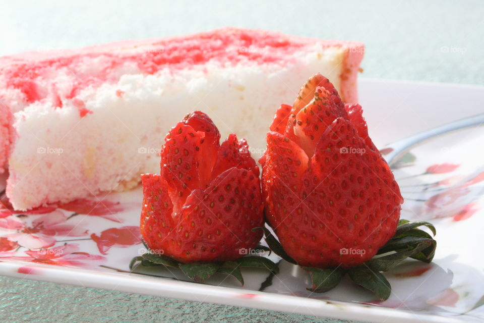Angel Food Cake with Strawberry Jello and Cool Whip with rose cut strawberries