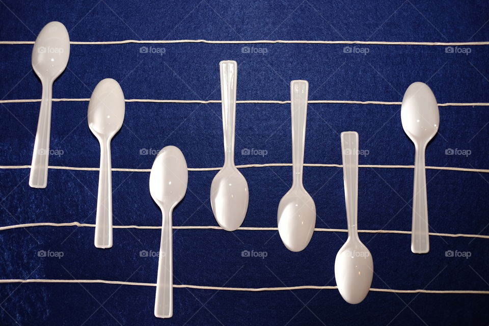 High angle view of plastic spoons