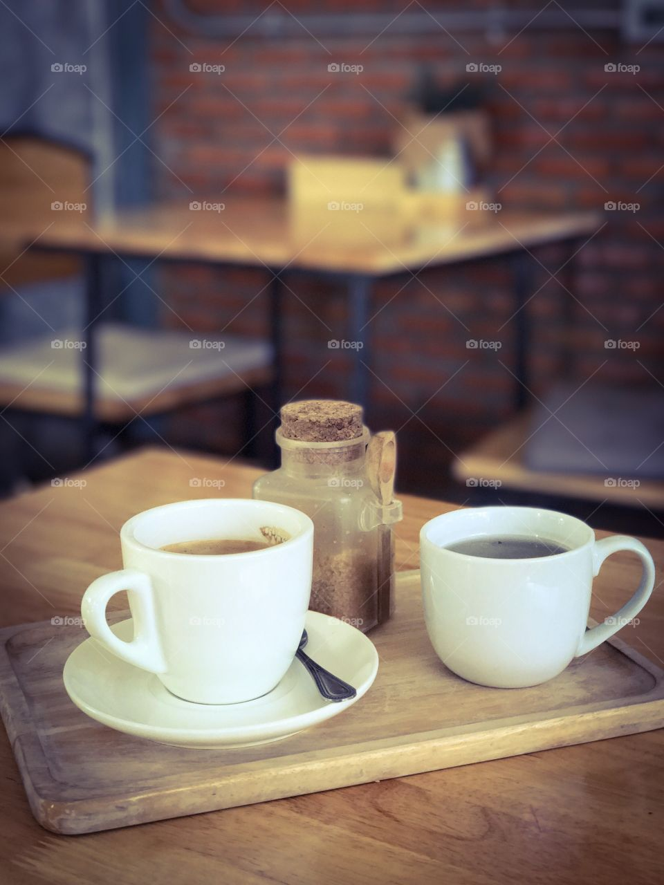 Cup of coffee and tea on wooden table