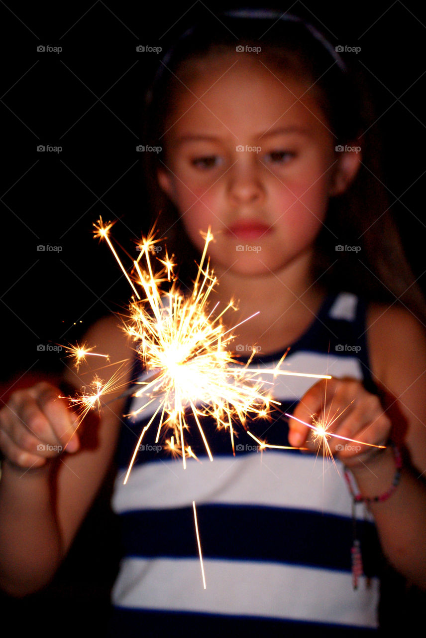 Girl holding sparklers in hand