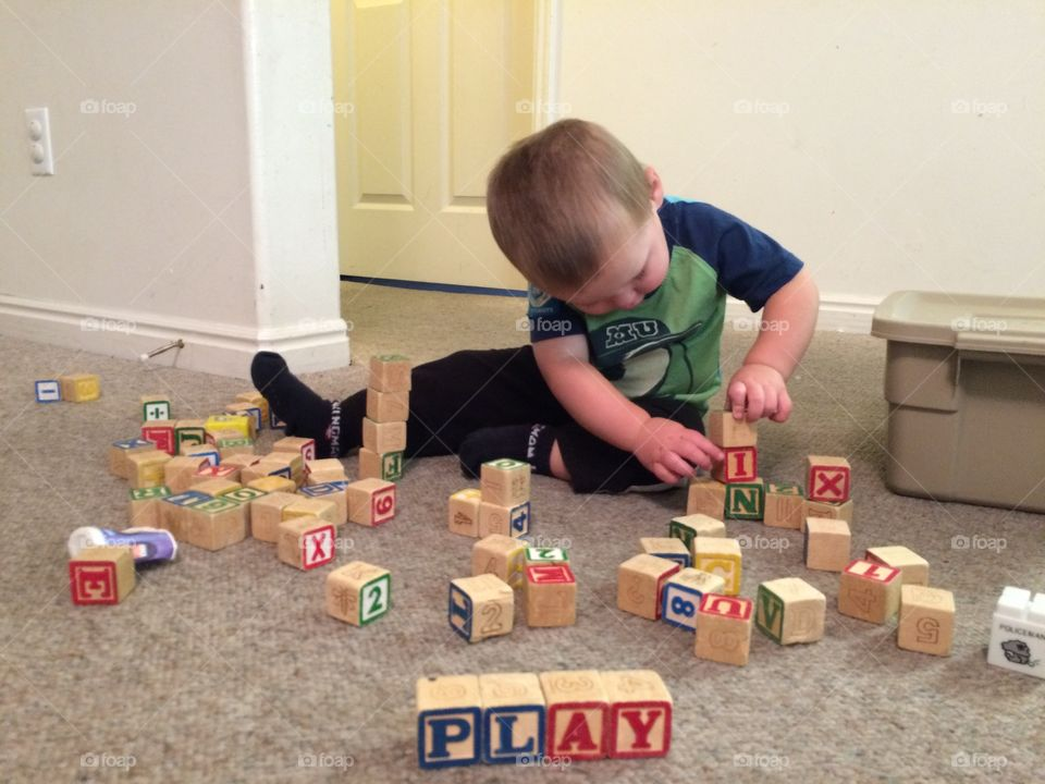 21 month old Alfred loves to play and build with his blocks.