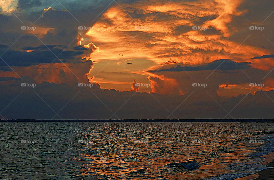 Sunrise, sunset and the moon - The golden sunset looks like a volcanic eruption captured with in the storm clouds