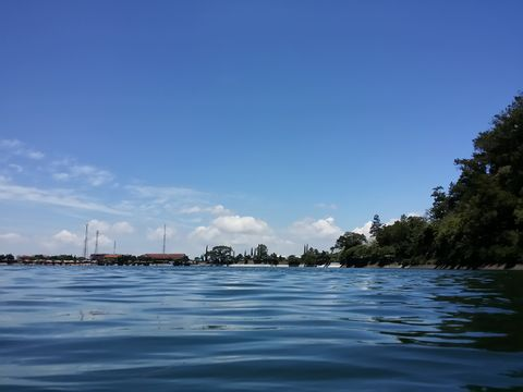 when the sky and water meet in the beauty of Sarangan, Indonesia
