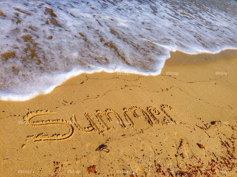 High angle view of summer text on sand