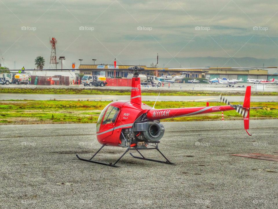 Helicopter Awaiting Flight. Robinson R-22 Helicopter On The Flightline