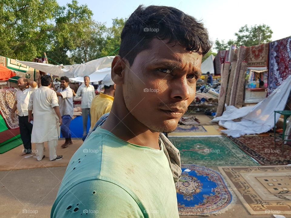 The survivor -This picture was taken at delhi india.He is a worker at old market where many people working hard for their survival.We may look weird to him and we could realise it from the way he look at us while we capture his reaction.His reaction and the pain on his eyes show us we are in a better place and we should appreciate it rather then complaining about our life.