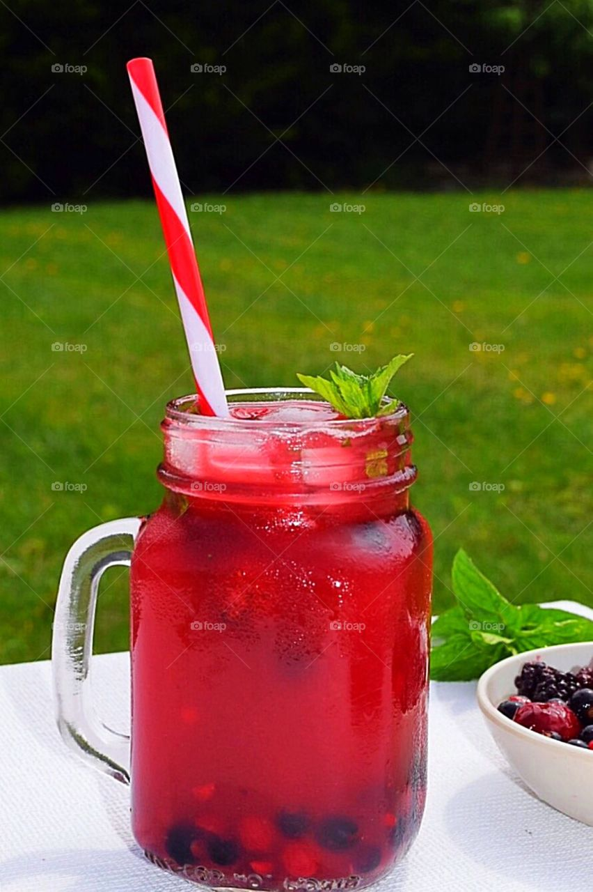 Berry juice with frozen berries and ice