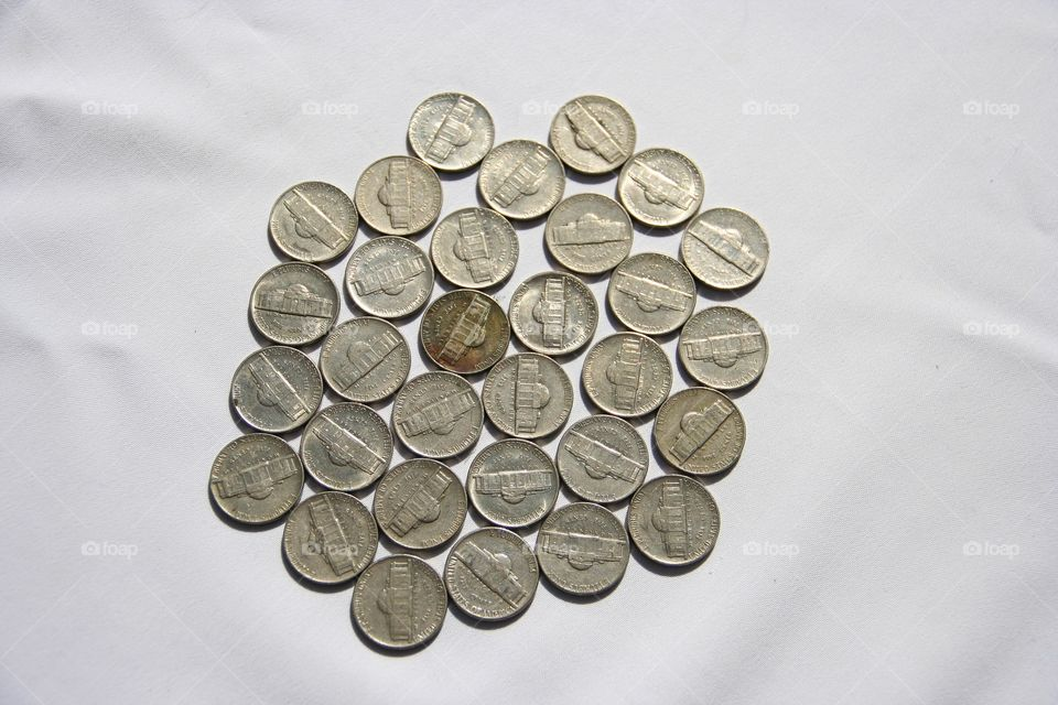Coins are used daily. Ellipsis are all around us. In your pocket and used in the shop