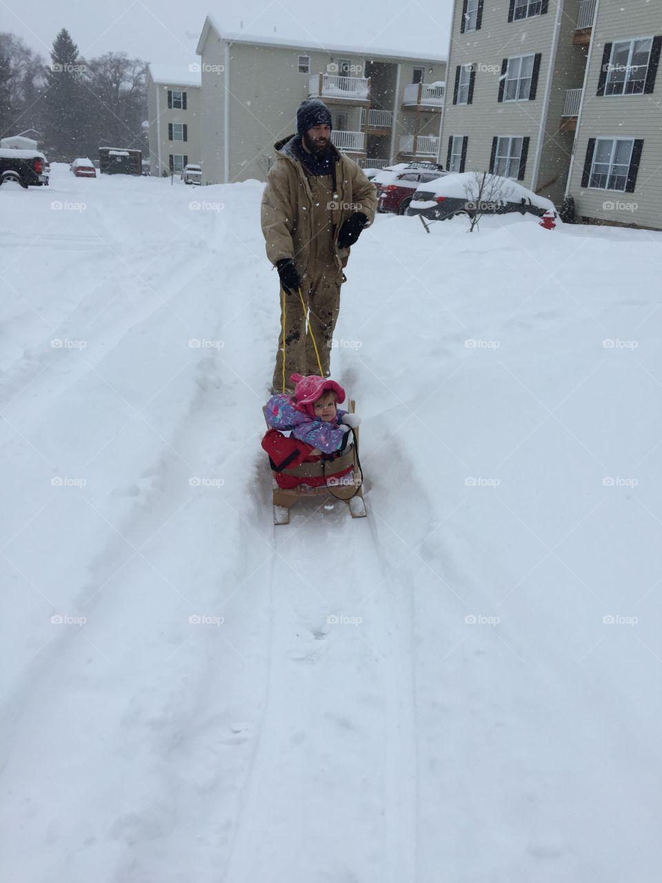 Snow baby. Sledding