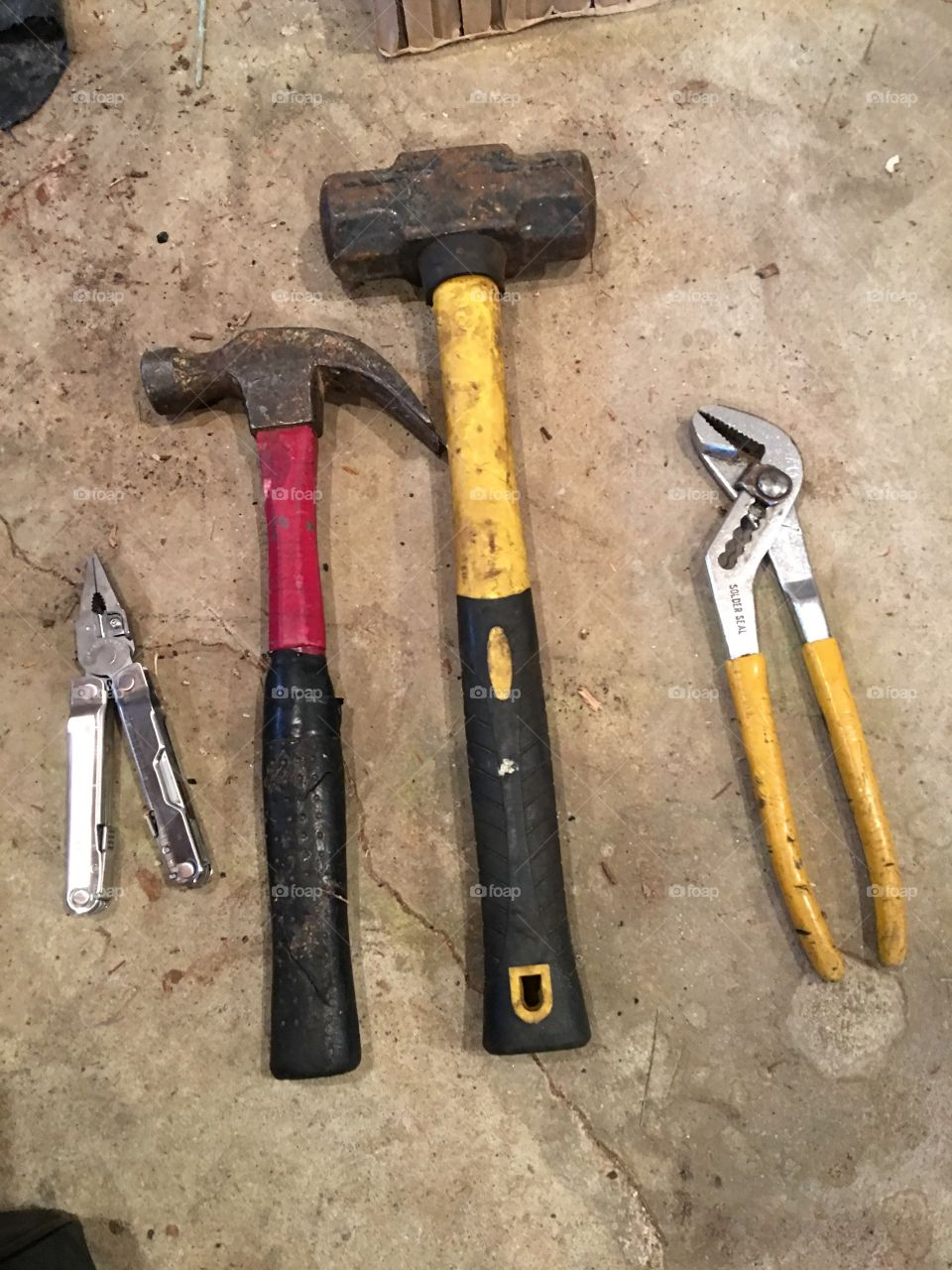 Leatherman tool, hammer, rubber mallet, wrench at the ready so I can help hubby!