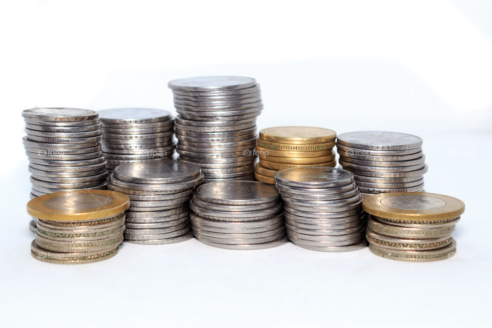 Stock pile of Hundred number 1, 10, 5 Indian rupee metal coin currency on isolated background. Financial, economy, investment concept. Banking and exchange object.