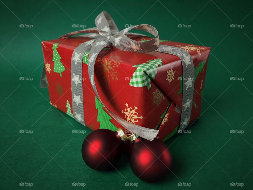 Christmas gift over green background