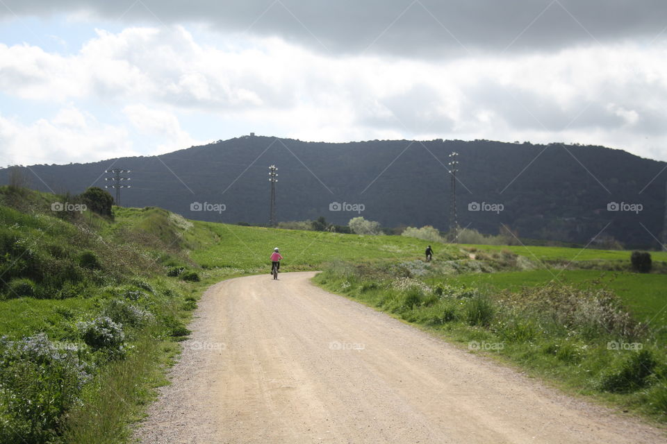 Landscape of mountains and cyclists walking