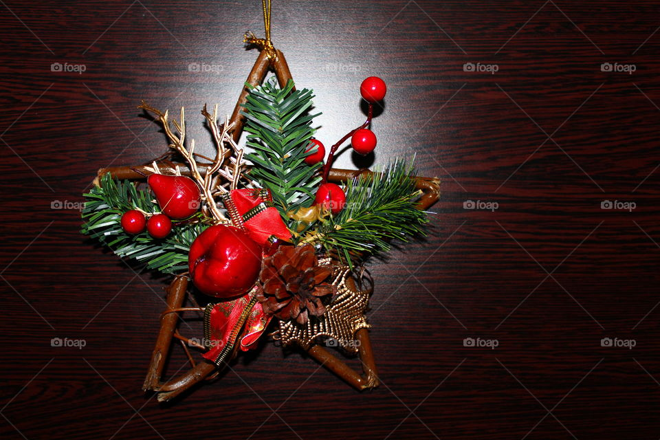 Christmas wooden star with decorations on a wooden table