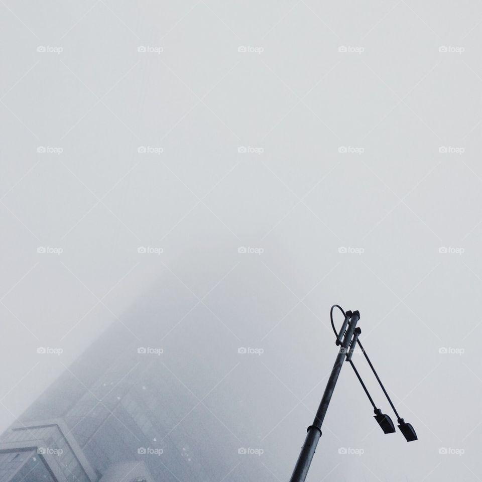 Skyscraper in the winter fog