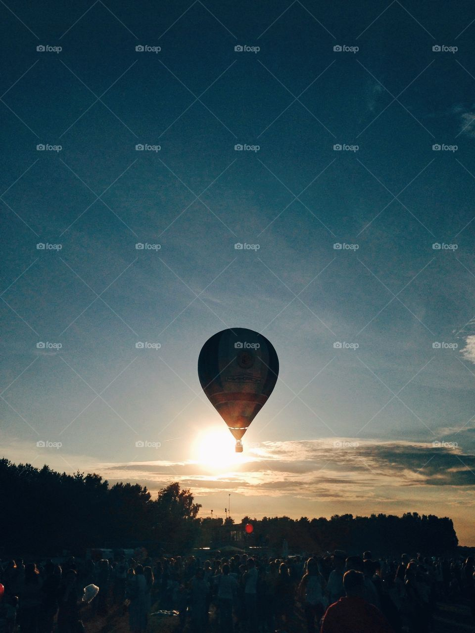 Hot air balloon flying in the sunset
