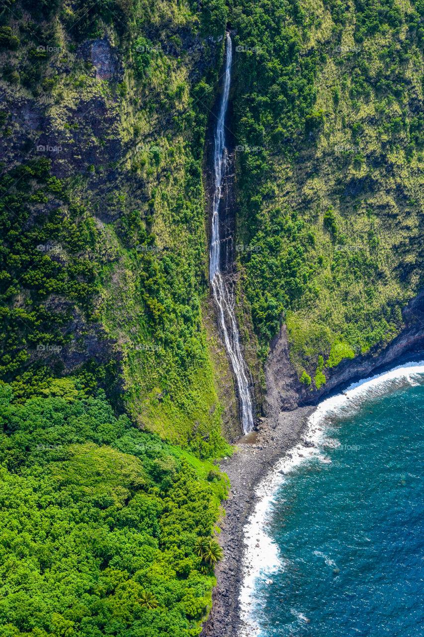 Waterfall and coast in Big island Hawaii