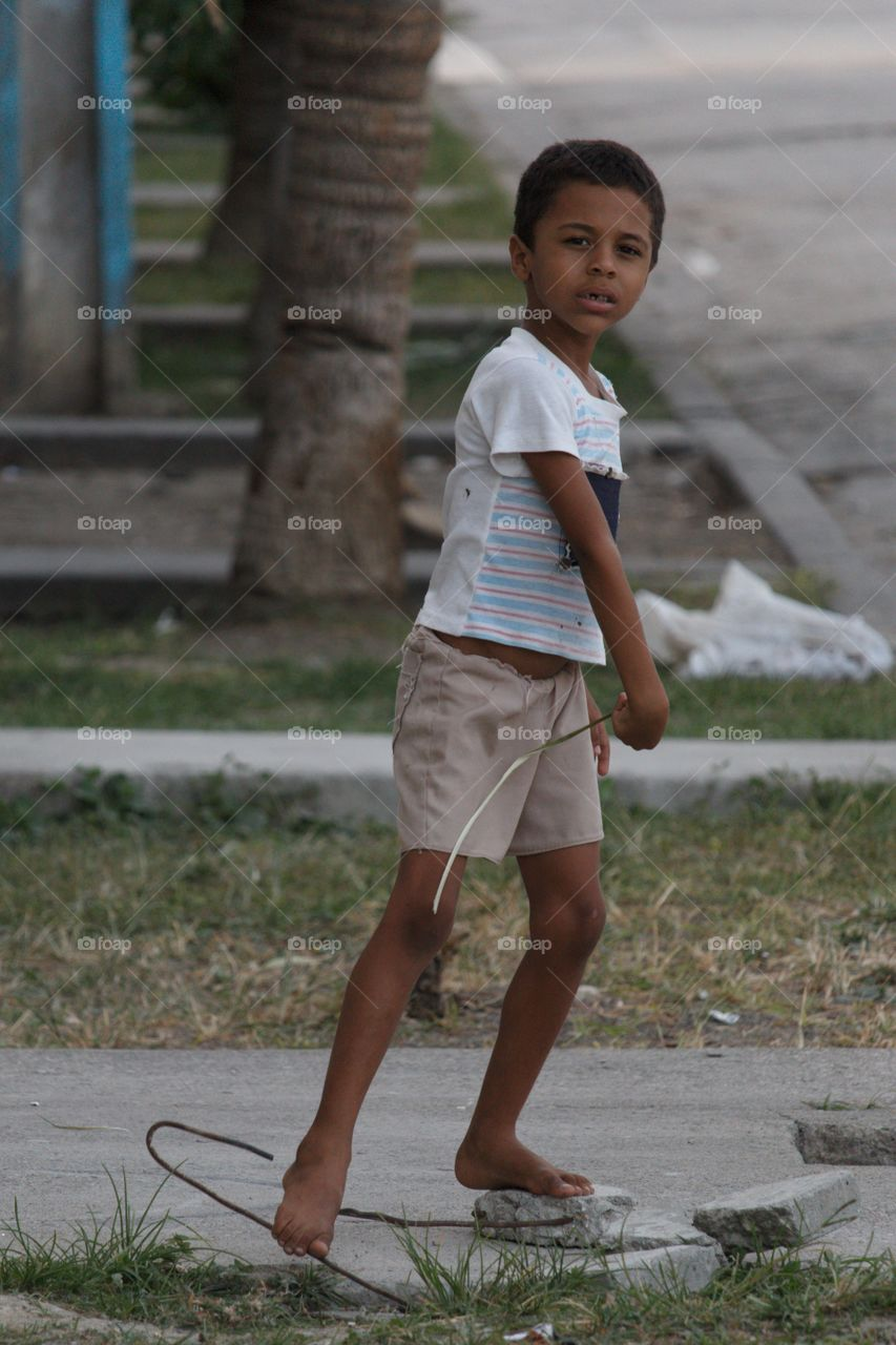 Portrait of Indian boy playing on street