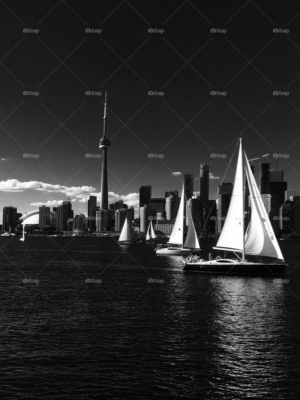 Toronto cityscape with boats in black and white